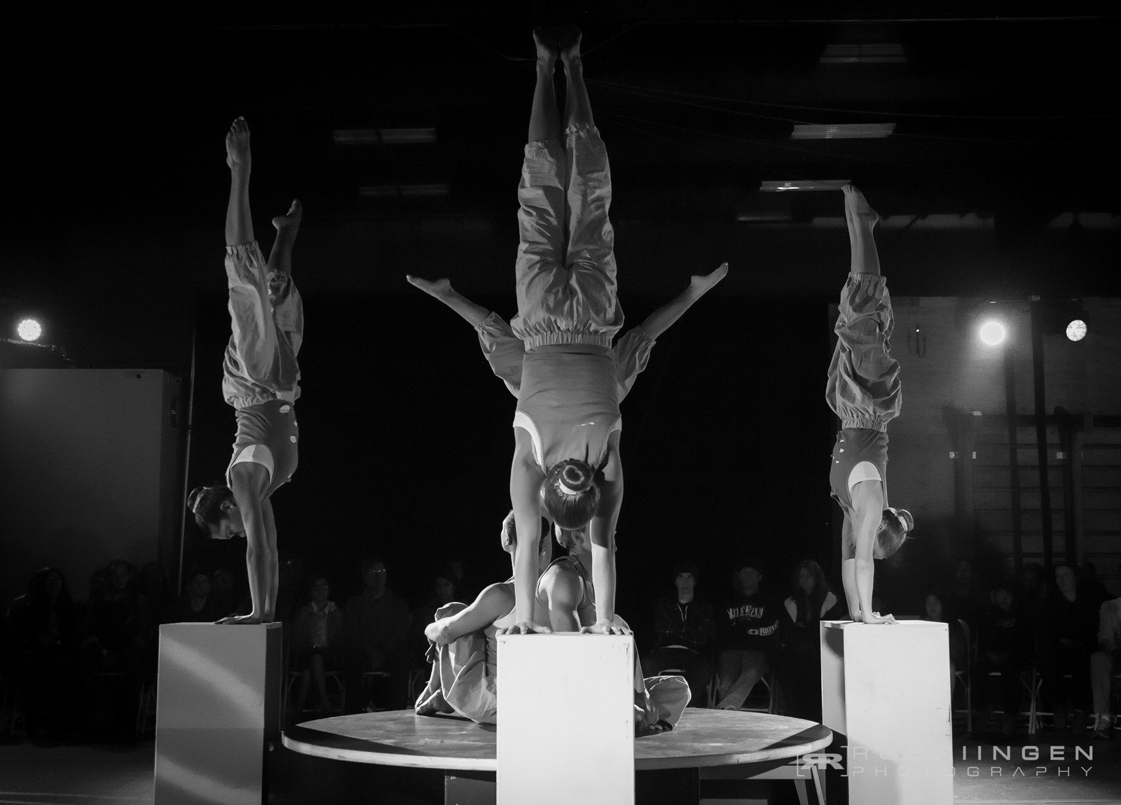 Handstands on boxes in group circus performance