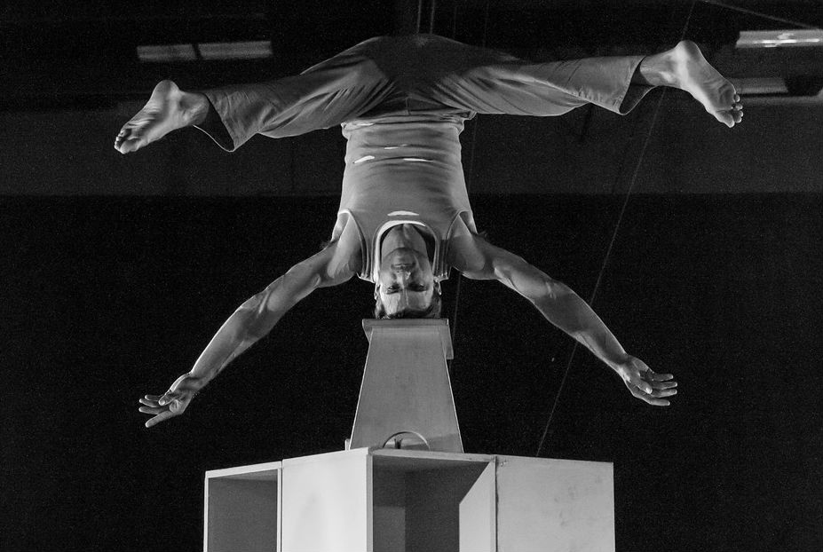 Balancing in headstand on elevated bench at San DIego Circus Center
